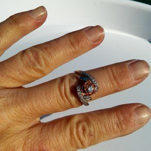 Women`s silver/rose gold tone rose ring. Size 9.